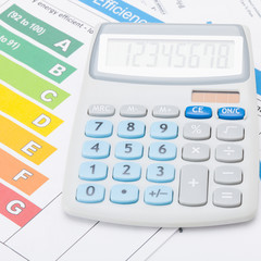 Calculator with energy efficiency chart - accounting concept