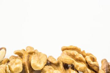 whole walnuts on white backround