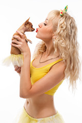 Glamour girl kisses small dog chihuahua