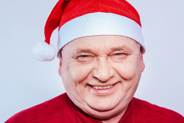 Mature man in Santa Claus hat