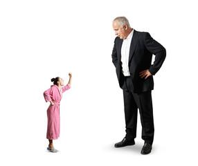 man looking at small angry woman