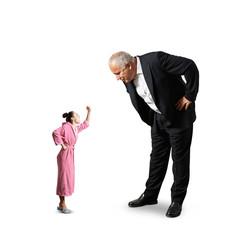 man looking at small screaming woman
