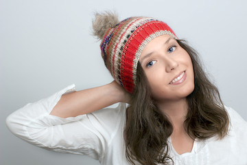 Smiling girl's face with knitted hat