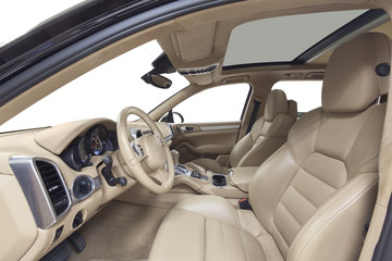 Interior of car. Beige cockpit with steel decoration