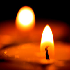 candles light in darkness