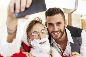 Santa Claus takes a Selfie with your barber