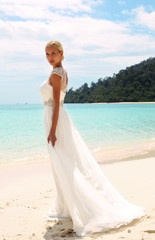 beautiful bride in wedding dress posing on island in Thailand