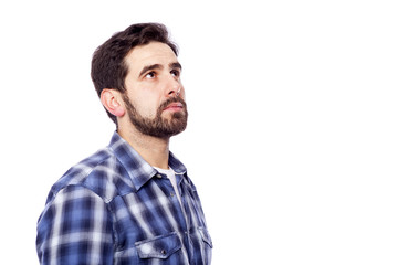 Pensive casual man looking up, isolated over white background