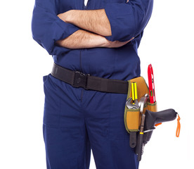Contractor standing with toolbelt on white background