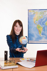 Young employee travel company with a globe in his hand
