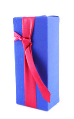 Wrapped gift box tied with a ribbon on white background