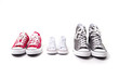 parents and child small shoes on grass in family love concept - 74695359