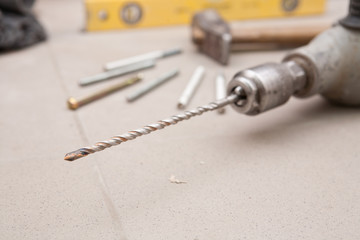 Drill-screwdriver with drills and nozzle