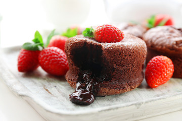 Hot chocolate pudding with fondant centre with strawberries,