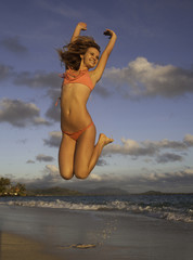 girl at beach jumping