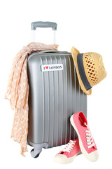 Travel suitcase, converse, scarf and hat isolated on white