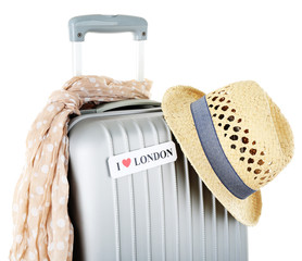 Travel suitcase, scarf and hat isolated on white