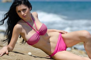 woman in bikini living on sandy beach, outdoor shot in sand