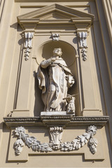 Sculpture in niche of facade church of the old Dominican convent
