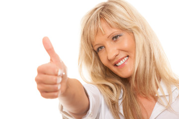 Mature woman giving thumbs up sign isolated