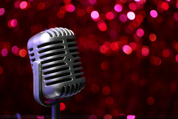 Silver microphone on red background