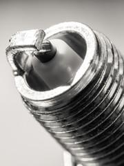 Auto service. New spark plug as spare part of car.