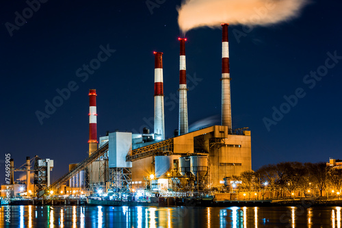 Staande foto Industrial geb. Power station with a steam cloud blown by the wind