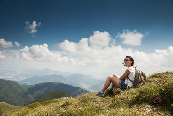 Woman highhiking have a time for rest on the mountain hill