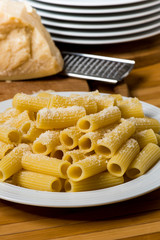 italian food called pasta with parmesan cheese on background