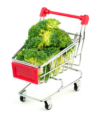 Mini shopping trolley stuffed with juicy green broccoli isolated