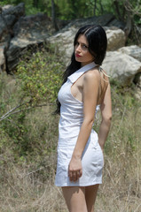 Girl in white dress, outdoor shooting during the summer day