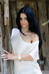 Beautiful woman front of wooden old house