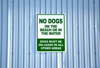 No dogs on the beach or in water sign