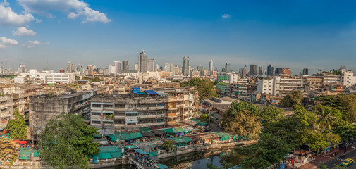 An aerial view of Bangkok city and old market along canal
