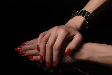 hands with red manicure