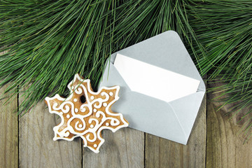 fir tree, envelope with gingerbread on wooden background