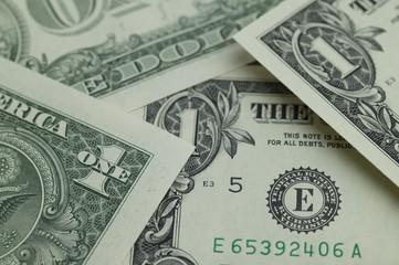 Several one dollar bills