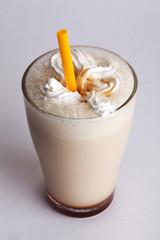 beige milkshake with straw