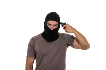 male thief wearing mask and holding gun isolated
