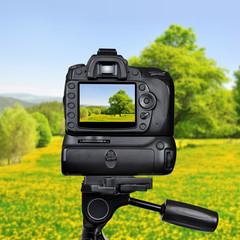 Dslr camera photographing spring landscape