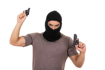 male thief wearing mask and holding guns isolated