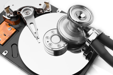 stethoscope on the hard disk drive over white