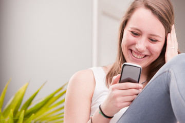 smiling girl using a phone