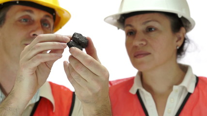 Miners Inspecting Carbon Graphite Ore