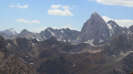 The crest of the mountains and clouds. TimeLapse, Pamir