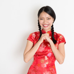 Asian chinese girl congratulating