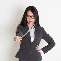 Asian female teacher holding a stick