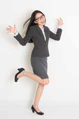 Full body Asian business woman cheering