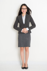 Full body Asian business woman