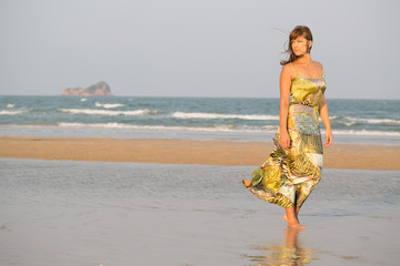 Beauty woman walking along a beach